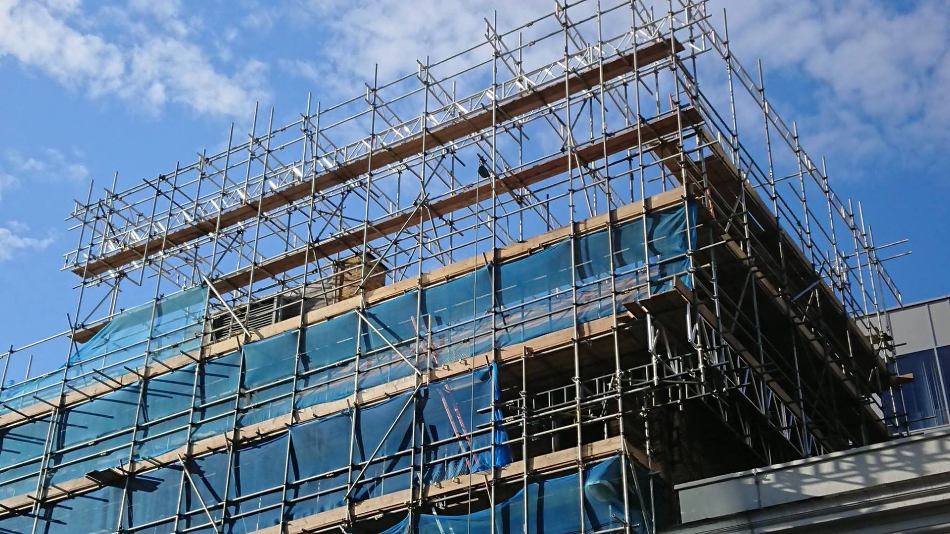 scaffolding with blue netting